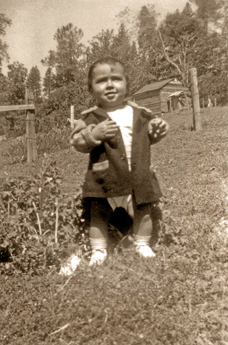 Richard Johnson, grandson of Peter and Margaret Johnson, pictured here as a baby on the Rancheria in the late 1940's. Richard currently sits as the Chairman of the Nevada City Rancheria Tribal Council.